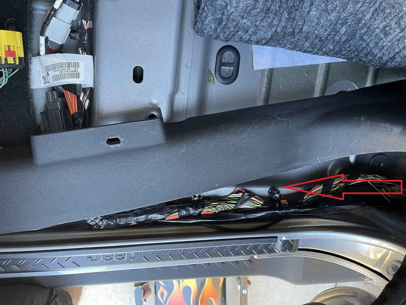 Run the wire to the area under the JK Wrangler passenger seat